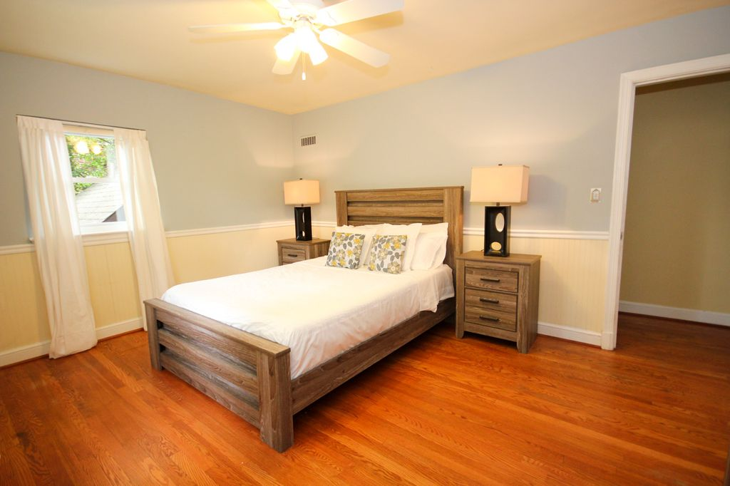 Contemporary Master Bedroom with Wainscoting & Hardwood floors in ...