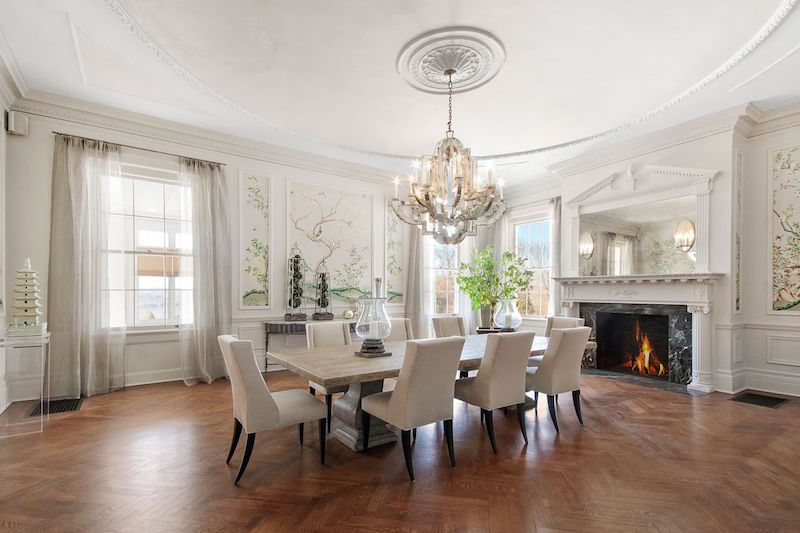 Transitional Dining Room With Chair Rail Wainscoting Stone Fireplace Crown Molding Chandelier