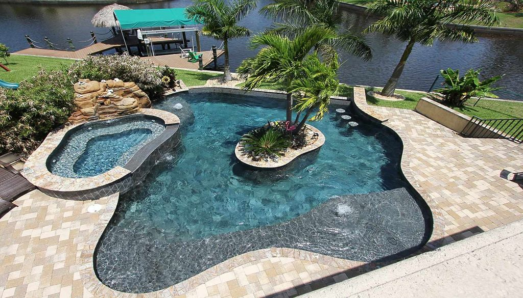 Tropical Swimming Pool With Exterior Brick Floors By