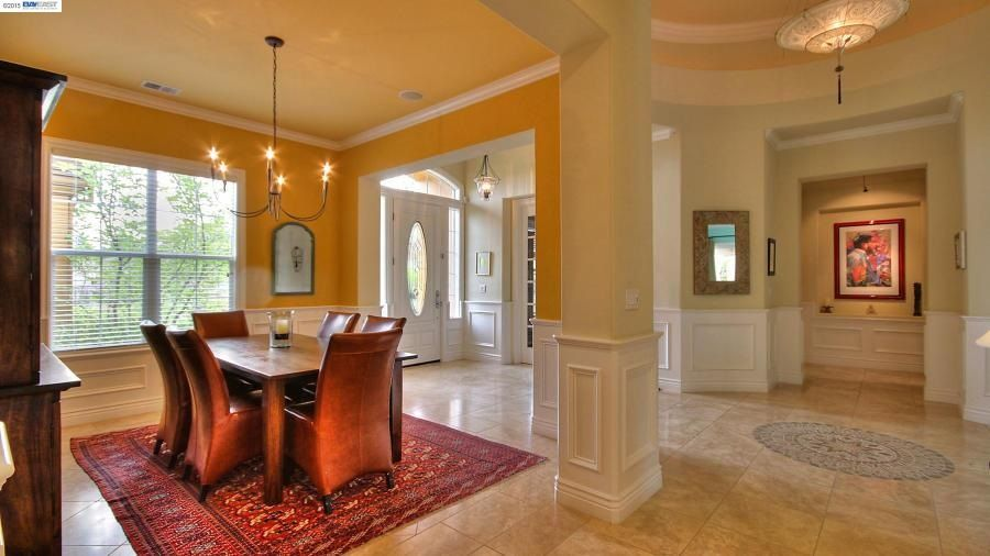 Traditional dining room with wainscoting columns in san for Dining room designs with pillars
