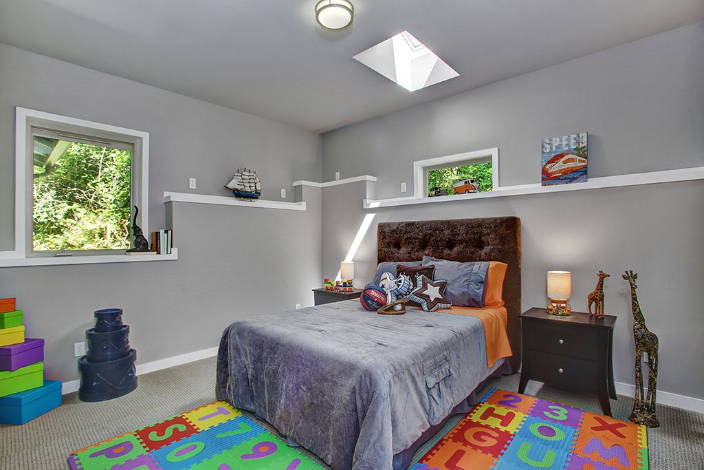 Kids Bedroom Carpet contemporary kids bedroom with high ceiling & skylight in seattle