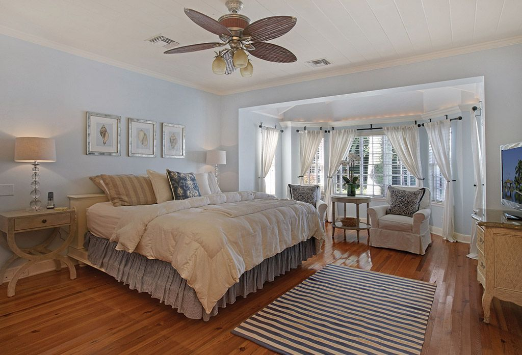 Country Master Bedroom with Bay window by The Corcoran Group ...