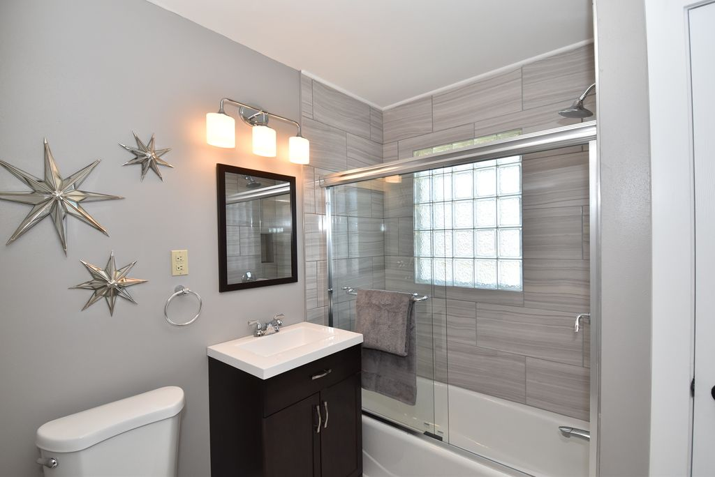 Contemporary full bathroom with frameless showerdoor for Zillow bathrooms