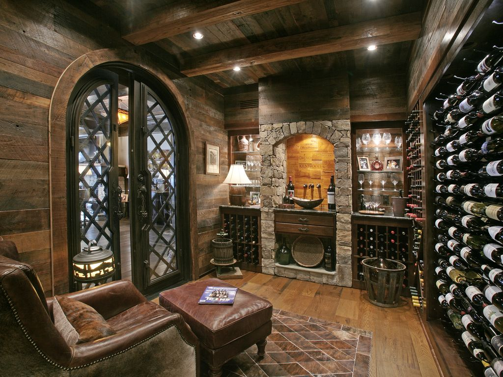 Rustic wine cellar with high ceiling by joe folsom Cellar designs