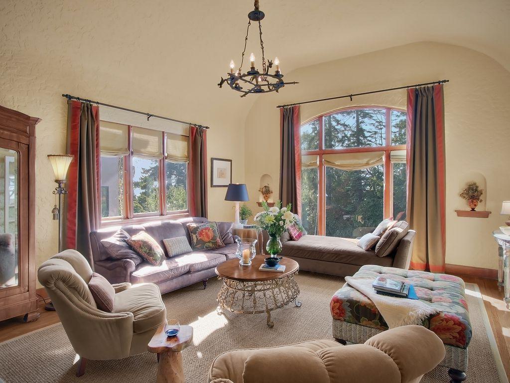 mediterranean living room with hardwood floors by sheila mayden