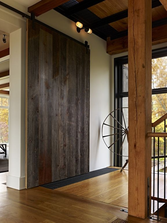 3 tags country entryway with spinning wheel columns hardwood floors rustica hardware vertical rustica reclaimed - Barn Door Design Ideas