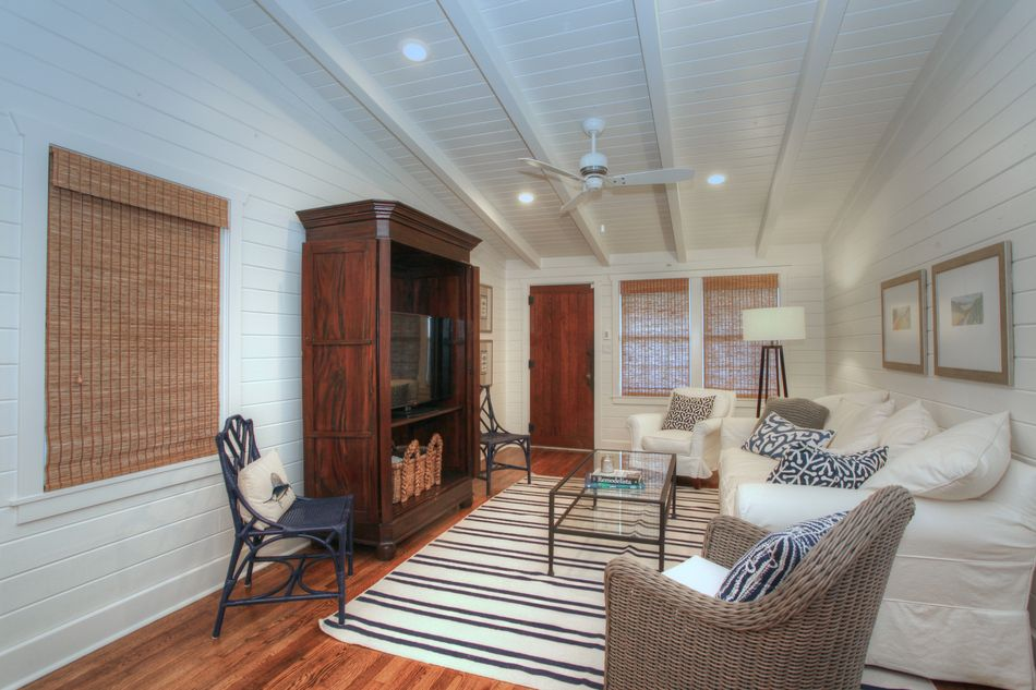 Cottage Living Room With Exposed Beam Pottery Barn Charleston Slipcovered Sofa Jaipur Rugs Maroc