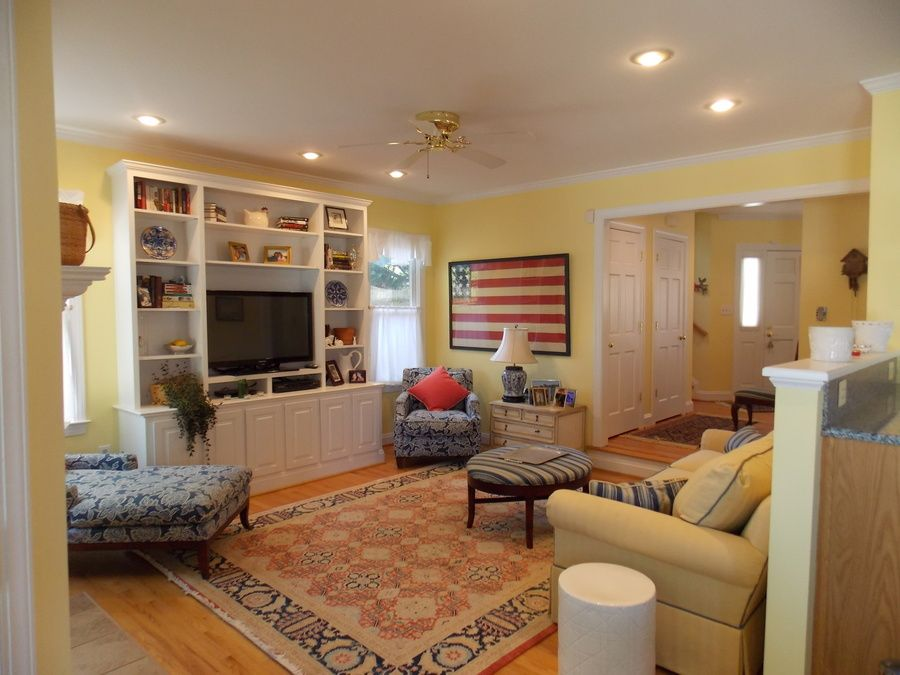 Country Living Room With Sunken Living Room, Crown Molding, Ceiling Fan,  Carpet,