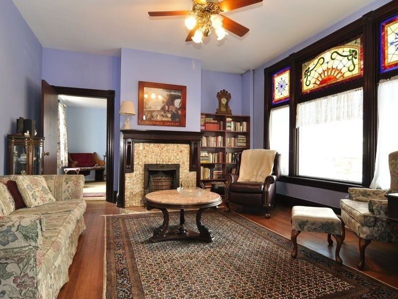 Craftsman Living Room with Hardwood floors & Stained glass window ...