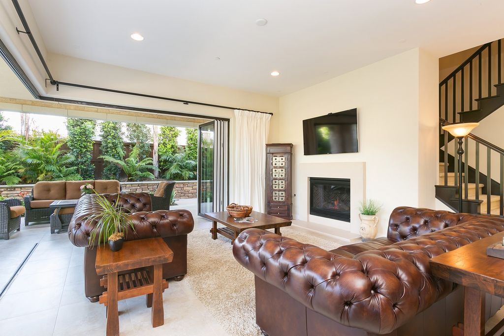Traditional Living Room With Wildon Home Sofa, Hako End Table, Travertine  Tile Floors,