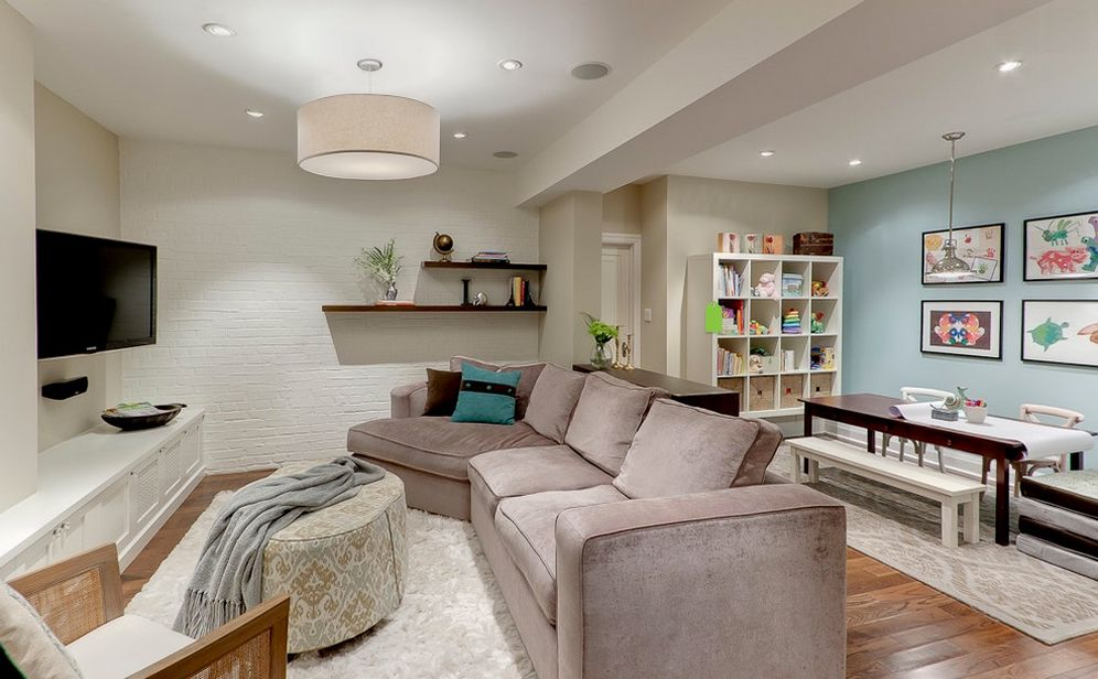 transitional great room with metro sofas with angled chaise carpet pendant light interior