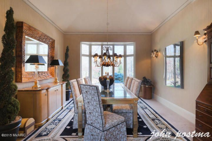 Traditional Dining Room With Carpet Wall Sconce Interior Wallpaper Crown Molding Chandelier