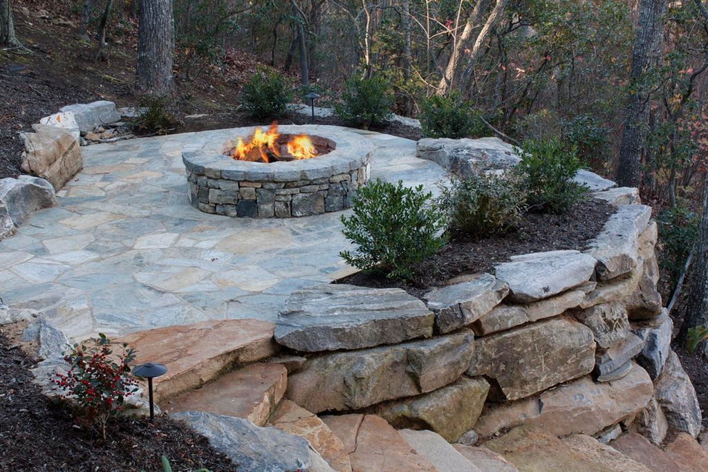 Rustic landscape and yard with exterior stone floors by for Rustic landscaping ideas pictures