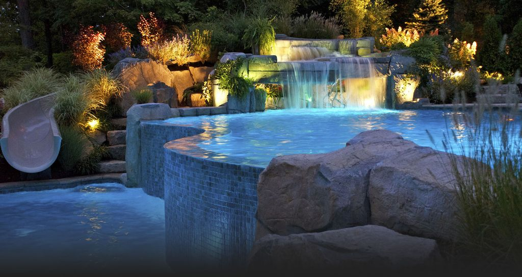 contemporary swimming pool with water slide pool with hot tub fountain ceramic tile