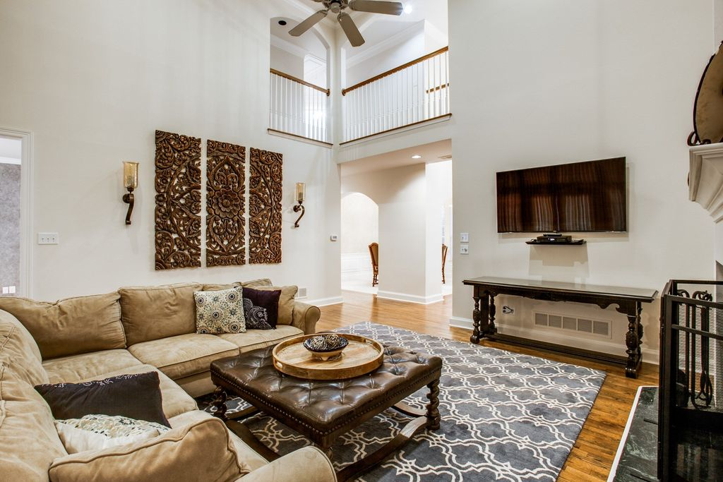 Living Room Wall Sconce. Traditional Living Room with Wall sconce  Balcony Hardwood floors Carpet High ceiling in Dallas