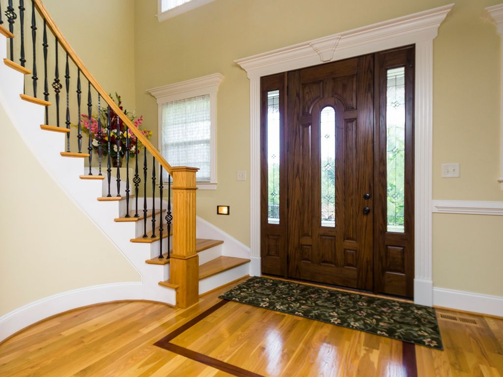 Chair Rail Entryway Part - 16: Traditional Entryway With High Ceiling, Hardwood Floors, Chair Rail, Carpet