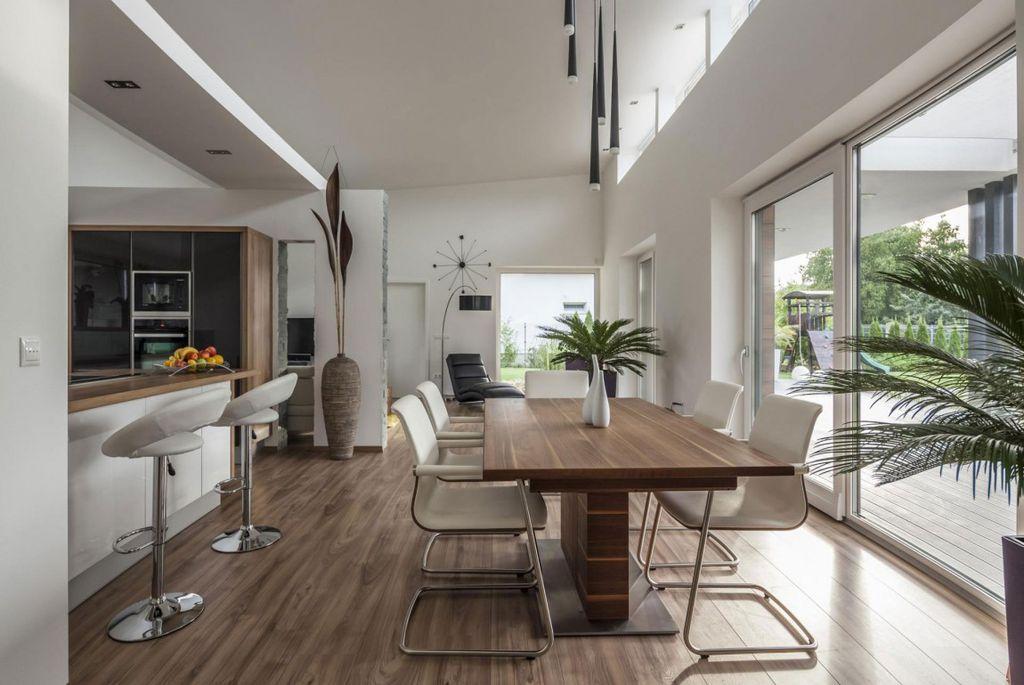 Modern Dining Room With Vibia Slim 0916 Pendant Light High Ceiling Hardwood Floors