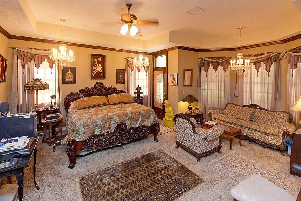 Traditional Master Bedroom with Ceiling fan & Transom window ...