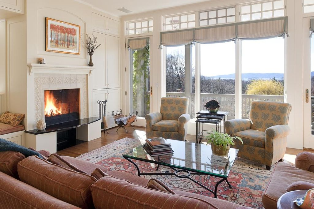 Traditional Living Room With Stone Fireplace Hardwood Floors French Doors Transom Window
