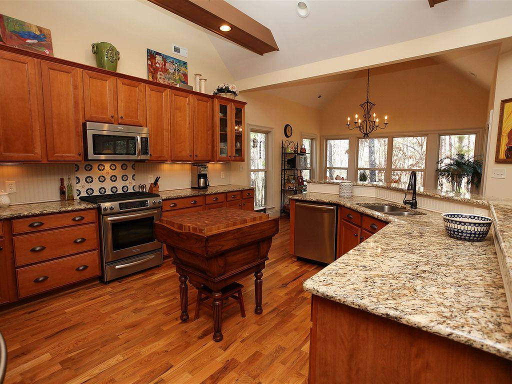 Craftsman kitchen with mexican tile backsplash complex granite craftsman kitchen with exposed beam glass panel mexican tile backsplash flush light dailygadgetfo Choice Image