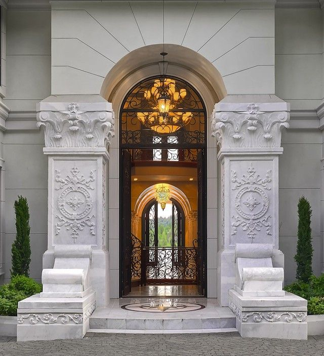 Art Deco Front Door With Pathway, Exterior Stone Floors, Raised Beds,  Transom Window