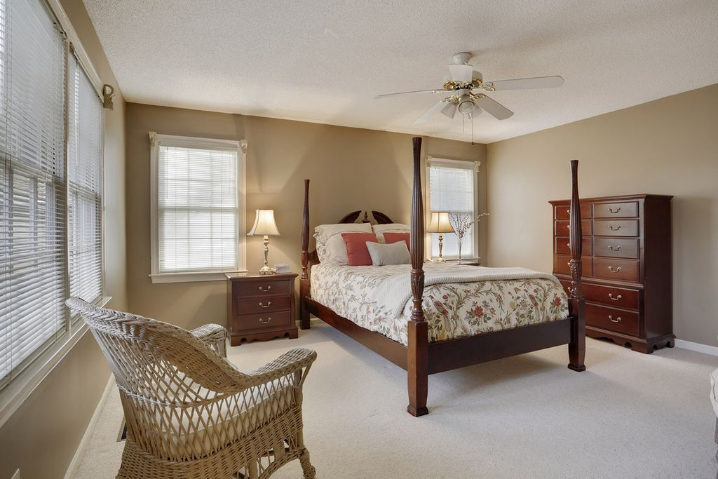 traditional master bedroom with carpet by karen cannon
