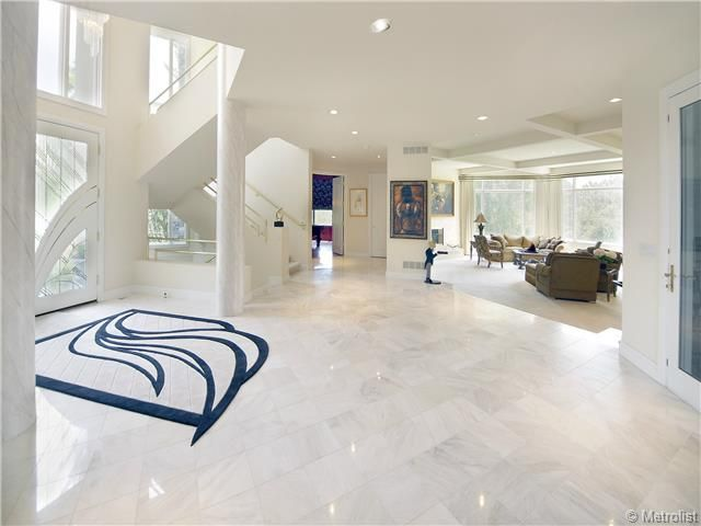 Modern Entryway With Simple Marble Tile Floors High Ceiling Specialty Door Columns