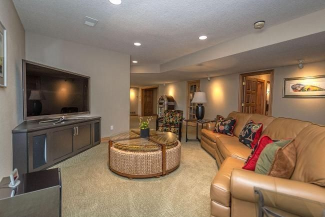 Contemporary Basement With Carpet, Flush Light, Woodbridge Home Designs  Corner TV Stand, Specialty