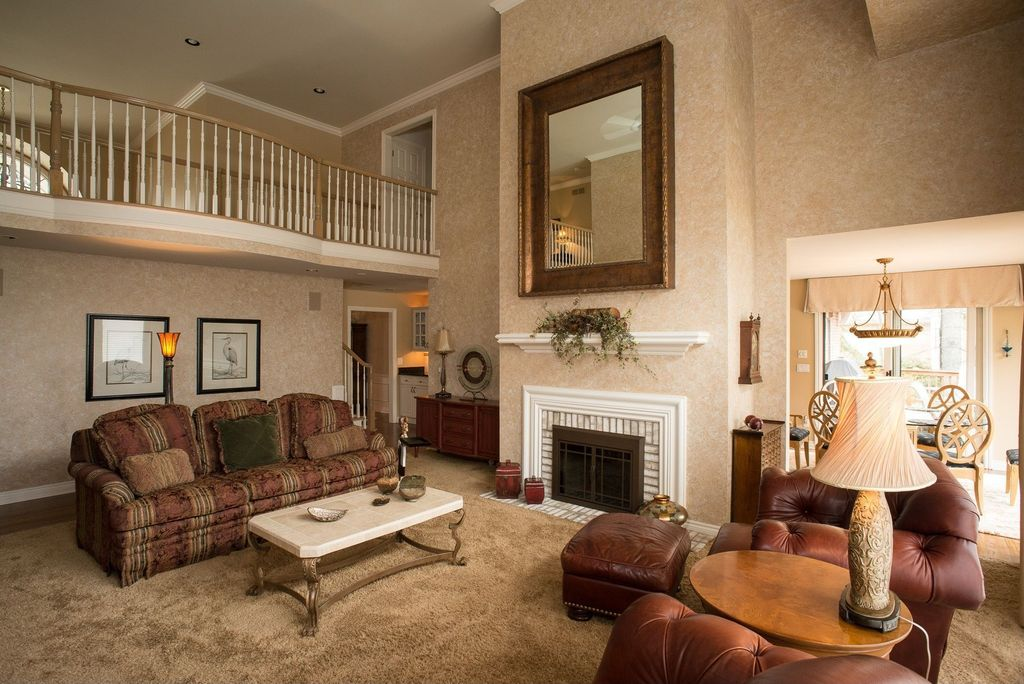 Traditional living room with carpet metal fireplace in for Balcony living room design