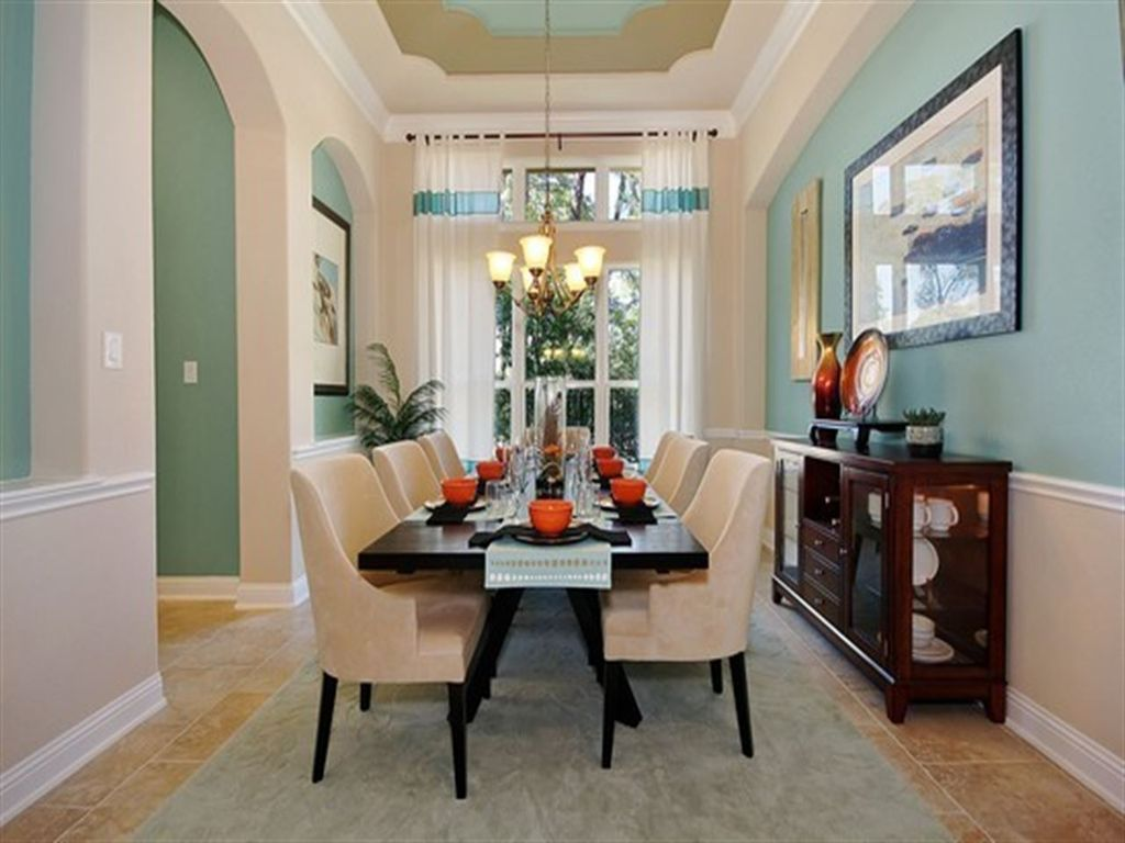 traditional dining room with pendant light & chair rail | zillow
