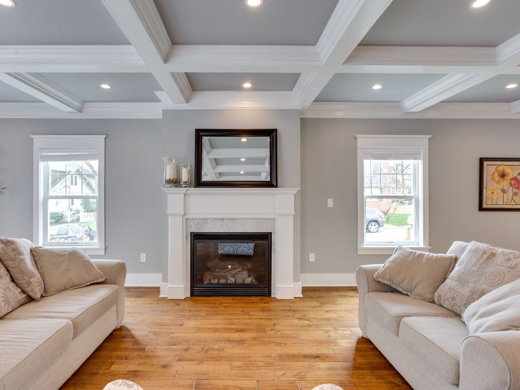 Traditional Living Room With Cement Fireplace Box Ceiling