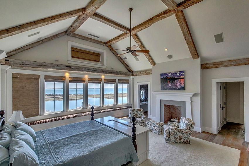 Traditional Guest Bedroom With Ceiling Fan Exposed Beam