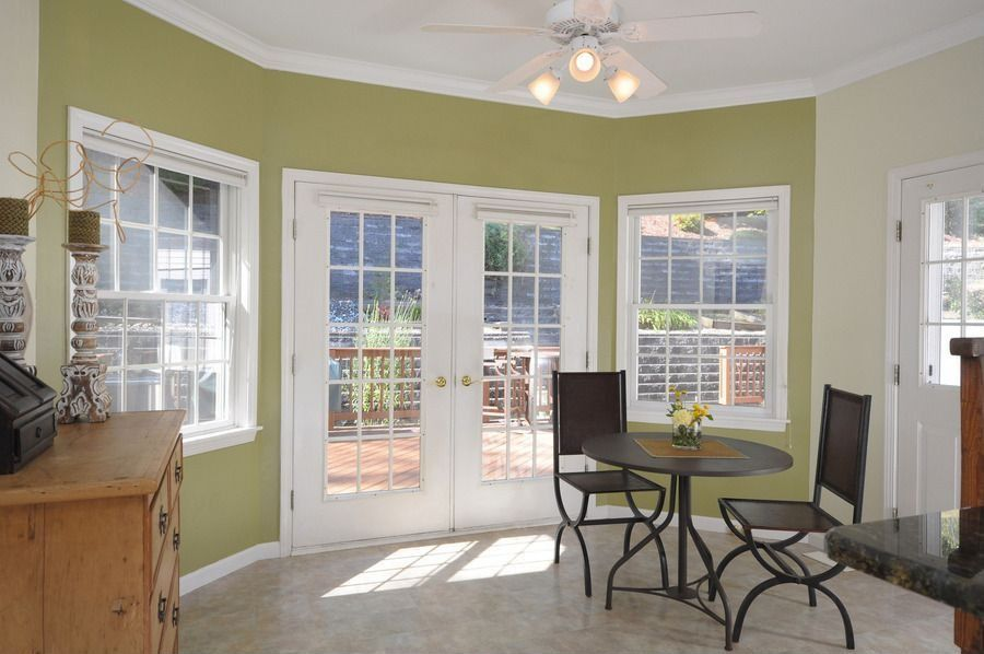traditional dining room with high ceiling & ceiling fan in basking
