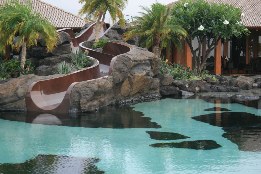Tropical Swimming Pool With Exterior Stone Floors By