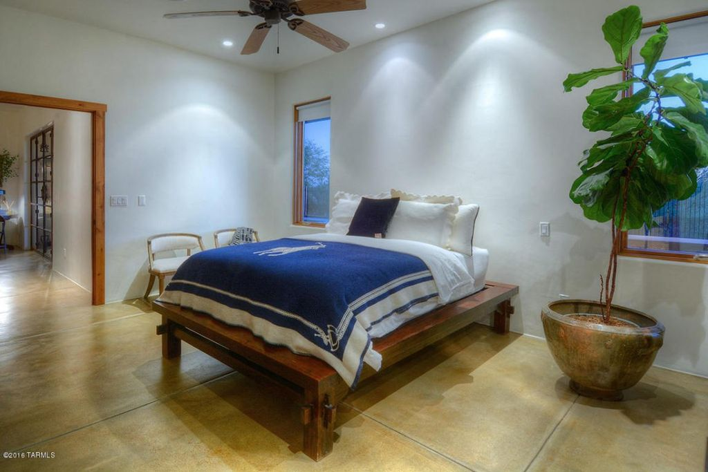 traditional guest bedroom with ceiling fan high ceiling concrete floors - Concrete Bedroom 2016