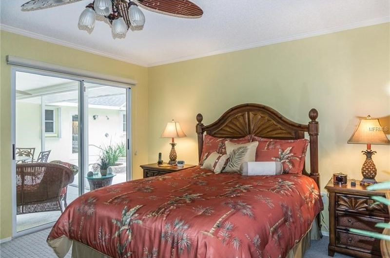 tropical guest bedroom with crown molding ceiling fan spice palm 8 piece comforter