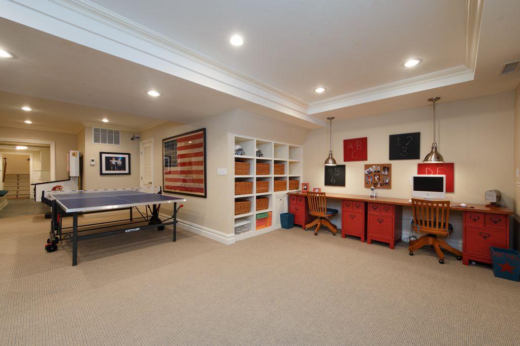 2 tags traditional basement with pendant light carpet crown molding built in bookshelf - Basement Design Ideas