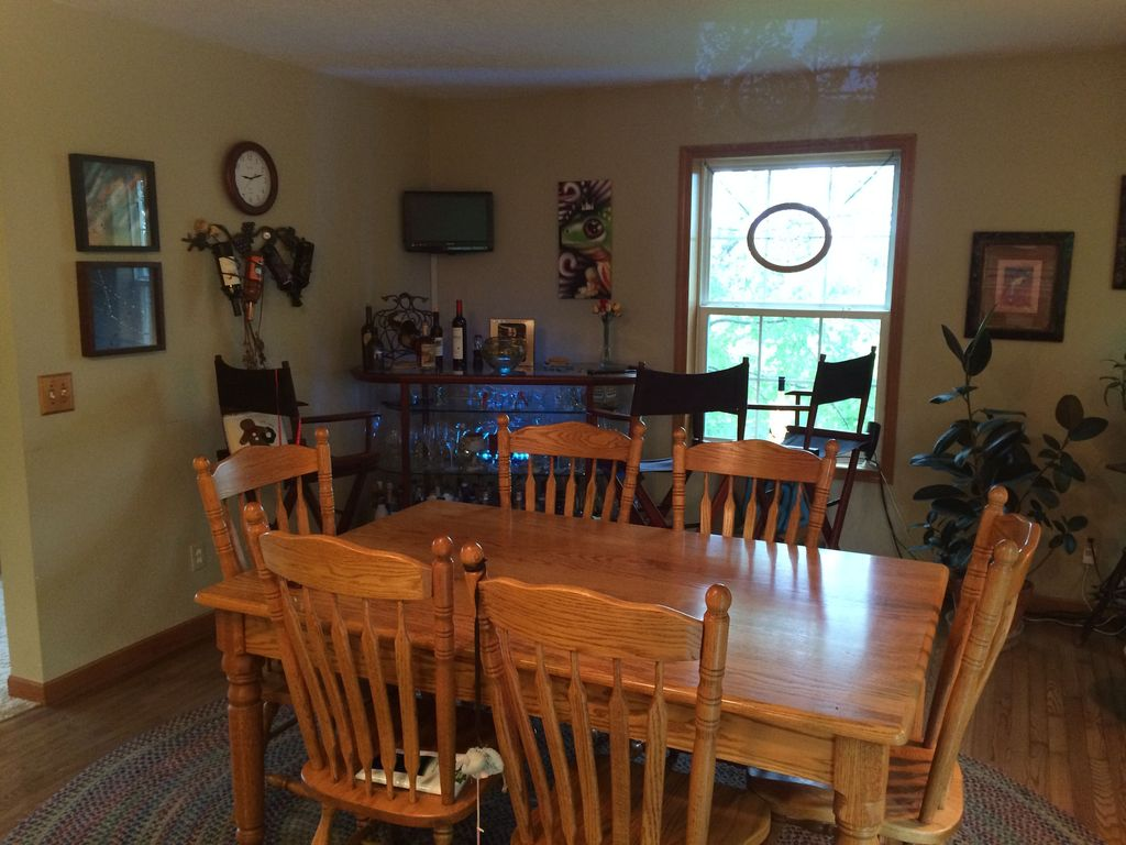 Country dining room with hardwood floors bar cart in manly ia zillow digs zillow - Country dining room pictures ...