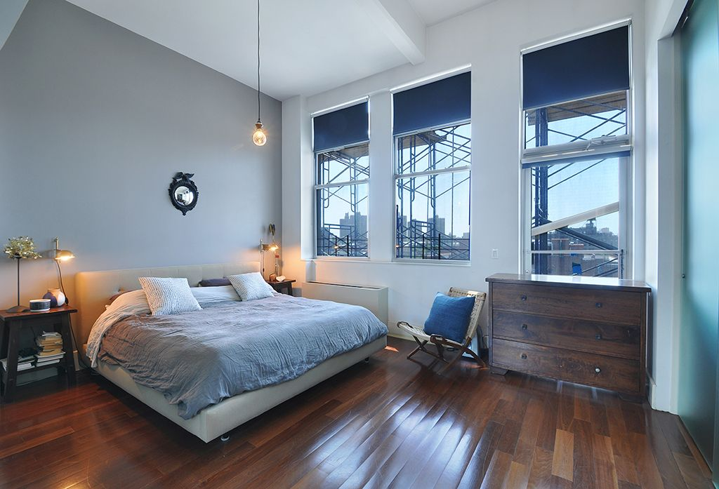 Contemporary Master Bedroom With Hans Wegner Style Rope Chair, Roller  Shades, Wall Sconce,