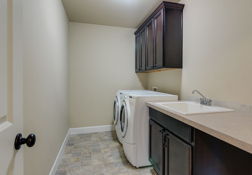 Laundry Room With Bruce Pathways Grand Coral Sand Laminate Flooring