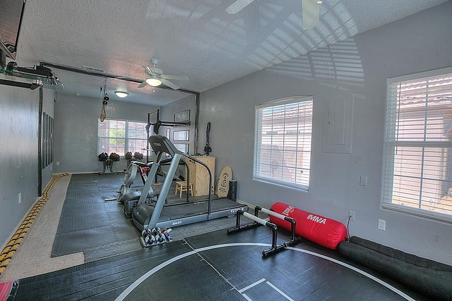 Contemporary home gym with flush light ceiling fan in