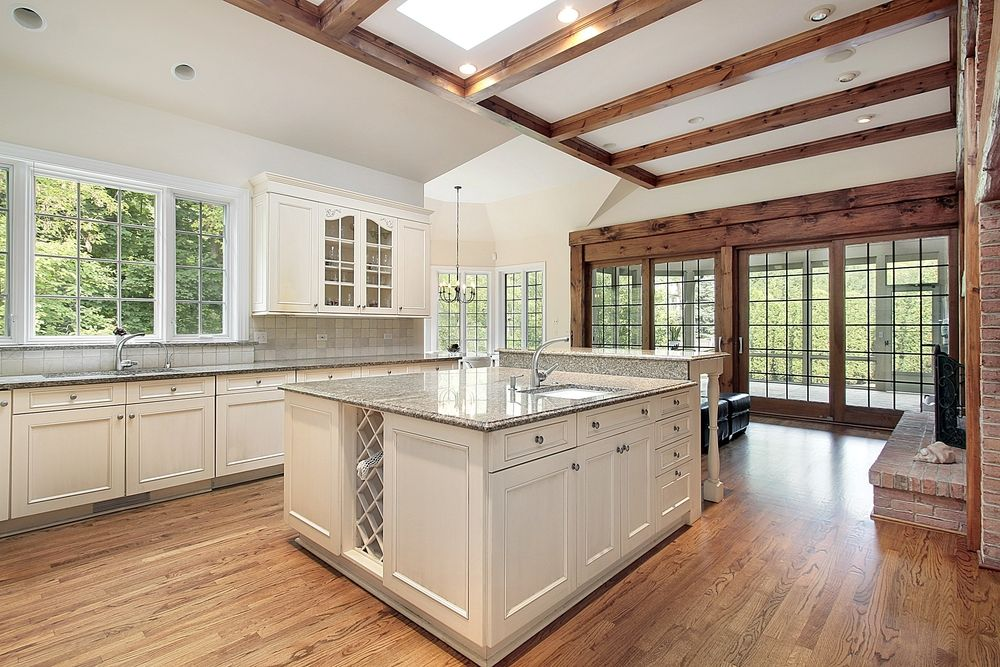 Traditional kitchen with undermount sink by home for Granite kitchen island designs