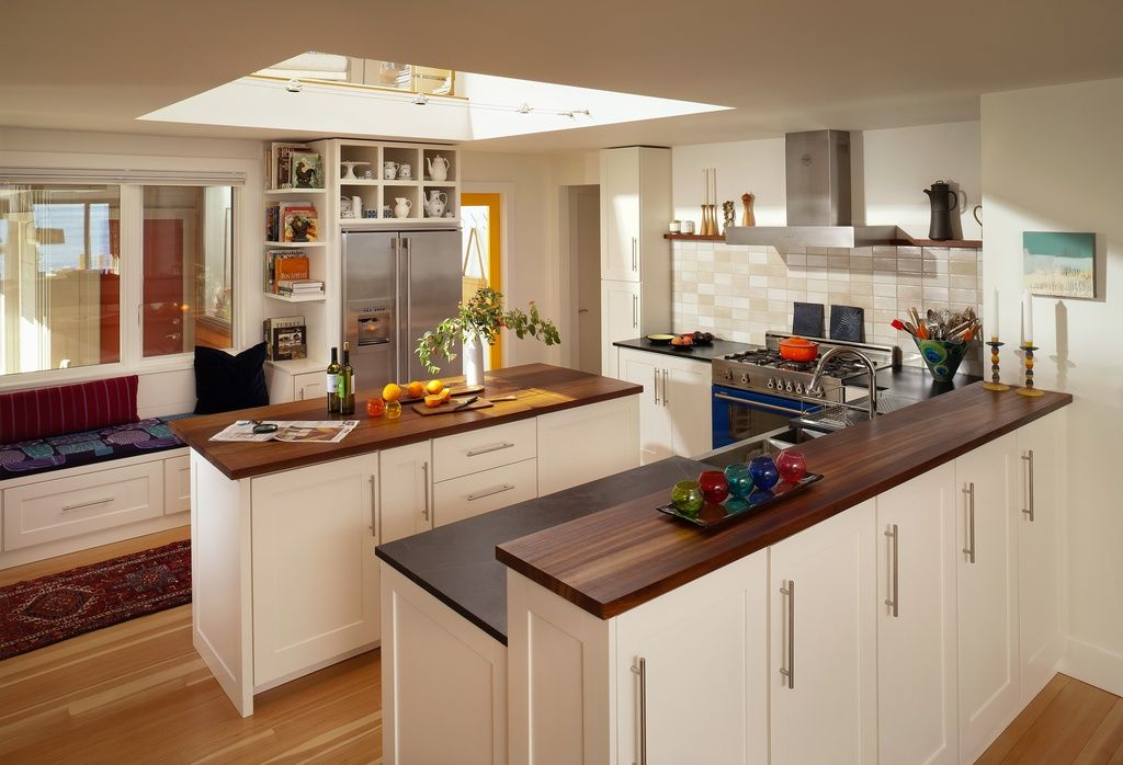 contemporary kitchen with u shaped flat panel cabinets high ceiling home decorators
