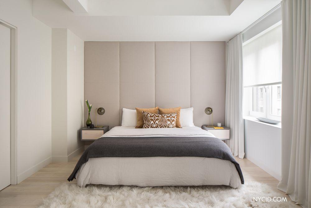 modern master bedroom with custom upholstered wall panels hardwood floors safavieh silken shag rug
