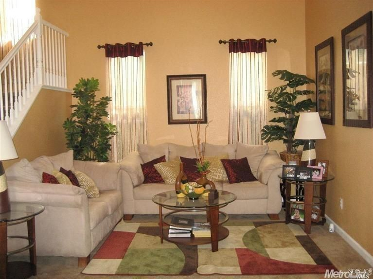 Traditional Living Room Rugs traditional living room with high ceiling & carpet in sacramento