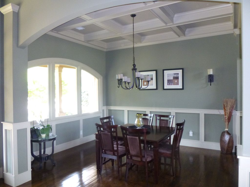Traditional Dining Room With Box Ceiling, Wall Sconce, Arched Window,  Wainscoting, Chandelier