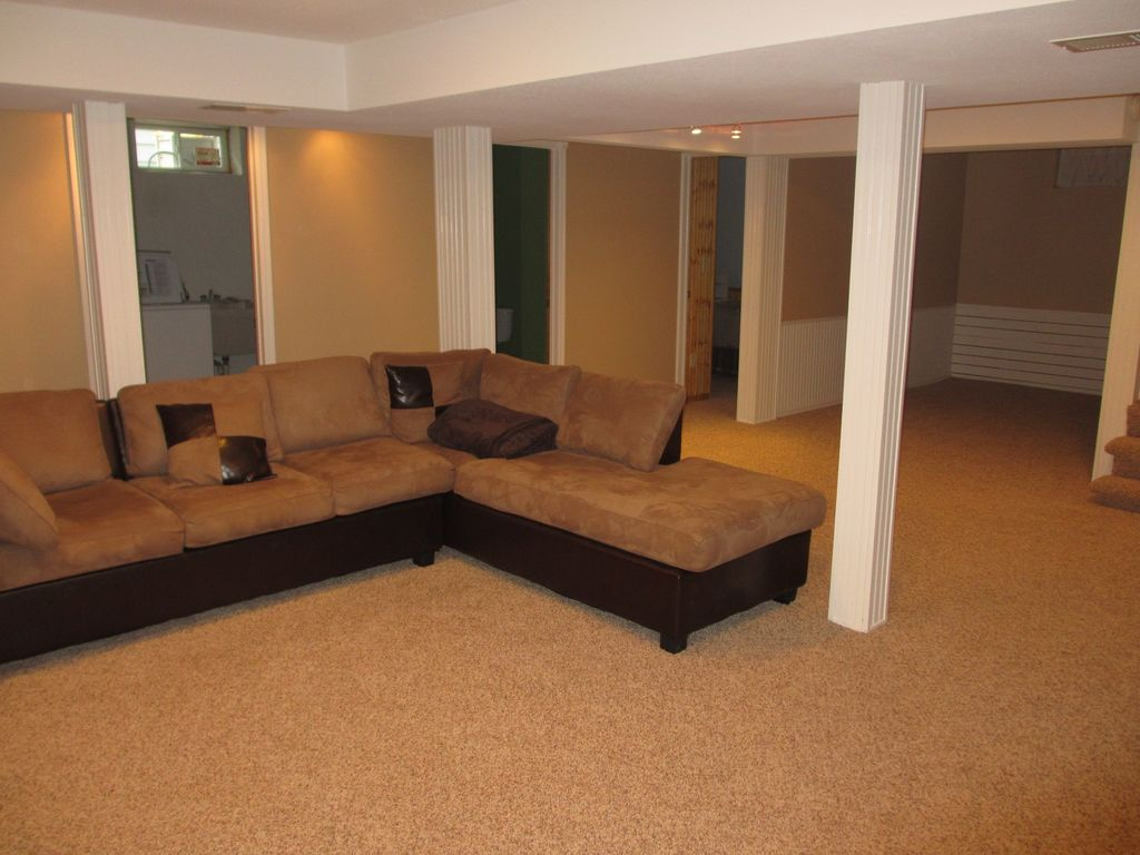 Traditional Basement With Amherst Sectional By Chelsea Home Warm Beige Berber Carpet