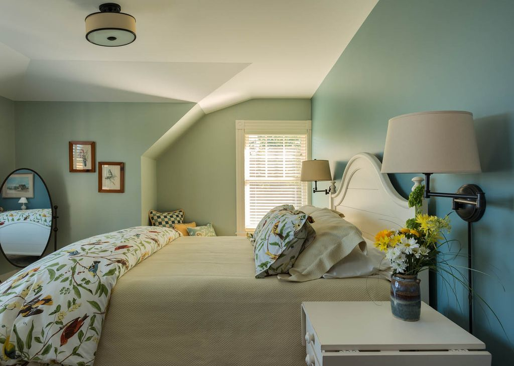 cottage master bedroom with home decorators collection simplicity swing arm wall lamp flush light