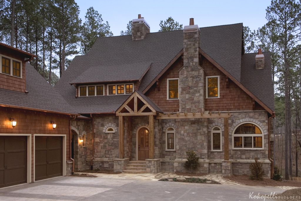 Rustic exterior of home by kokopelli builders inc for Exterior stone design houses
