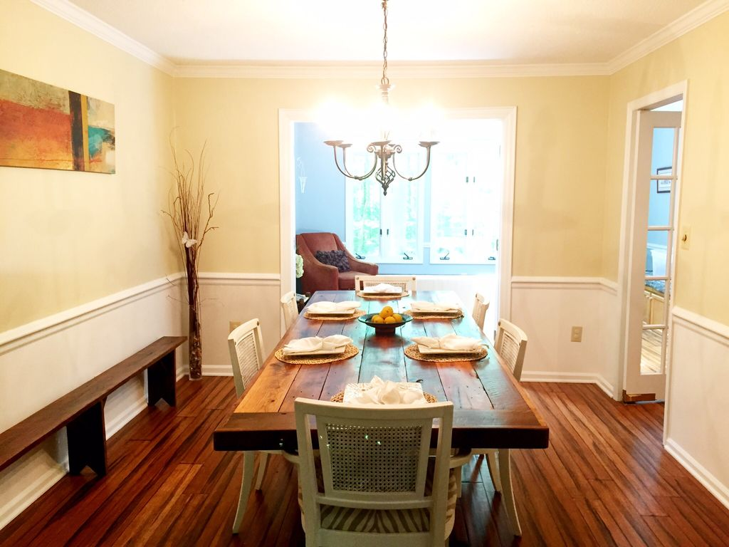 Eclectic Dining Room With Wainscoting Pendant Light Shaker Bench Hardwood Floors Rustic